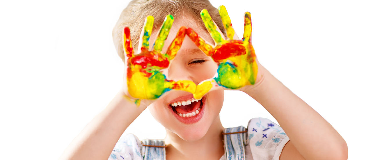 Girl having fun with colorful painted hands